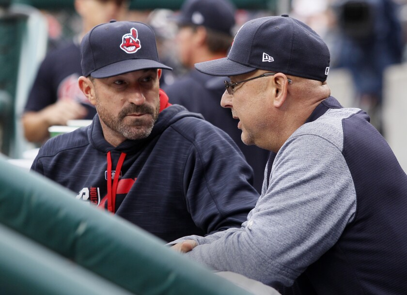 Cleveland Indians pitching coach Mickey Callaway speaks with manager Terry Francona during a game in September 2017.
