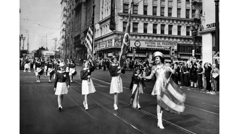 Nov. 11, 1943: The Monterey Park Girls' Drum and Bugle Corps march in the fourth parade held in Los