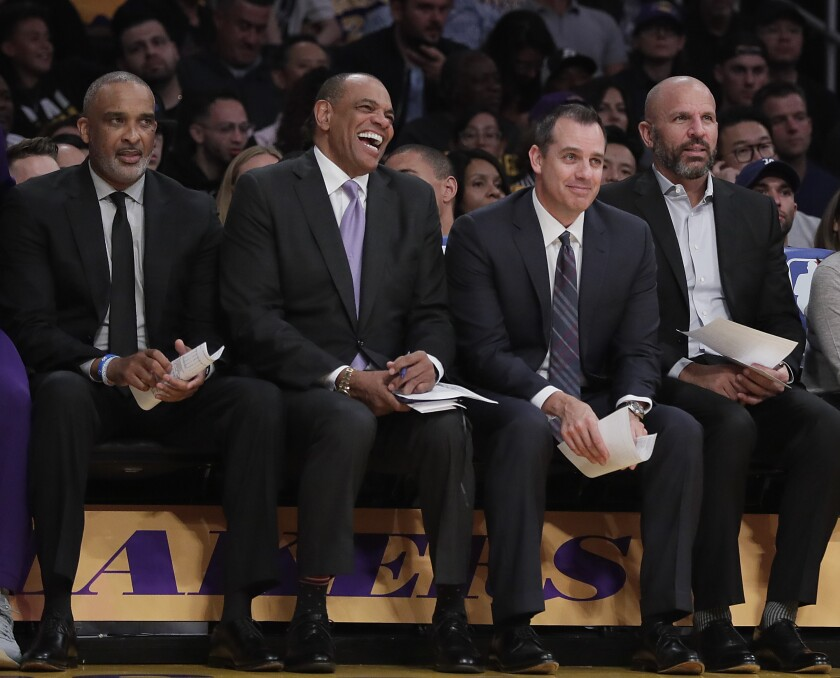 Lakers coach Frank Vogel on the bench with his top assistants, from left, Phil Handy, Lionel Hollins and Jason Kidd.