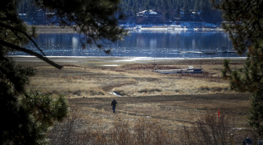 Vincent Ward walks on the north shore of the lake on an annual survey of the bald eagle population at Big Bear Lake.