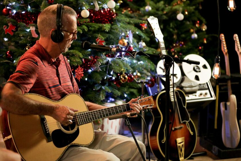 Eric Clapton's first ever full-length studio holiday album, Happy Xmas, set for release on October 1