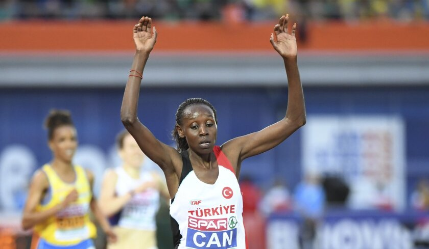 Turkey's Yasemin Can celebrates as she wins the women's 5000m event, at the European Athletics Championships in Amsterdam, the Netherlands, Saturday, July 9, 2016. (AP Photo/Geert Vanden Wijngaert)