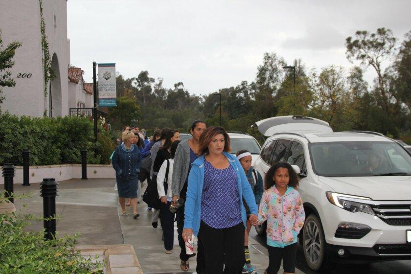 R. Roger Rowe teachers walk into school together in solidarity. Photo by Karen Billing