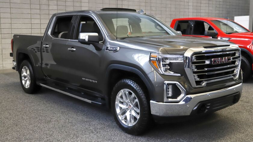 This is a GMC 2019 Sierra 1500 4WD Crew Cab SLT truck on display at the 2019 Pittsburgh Internationa