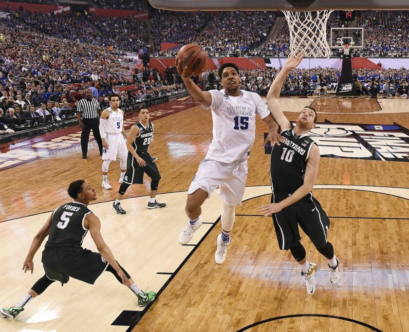 Duke's Jahlil Okafor (15) drives to the basket past Michigan State's Matt Costello (15) during the first half of the NCAA Final Four tournament college basketball semifinal game Saturday, April 4, 2015, in Indianapolis. (AP Photo/Chris Steppig, Pool)