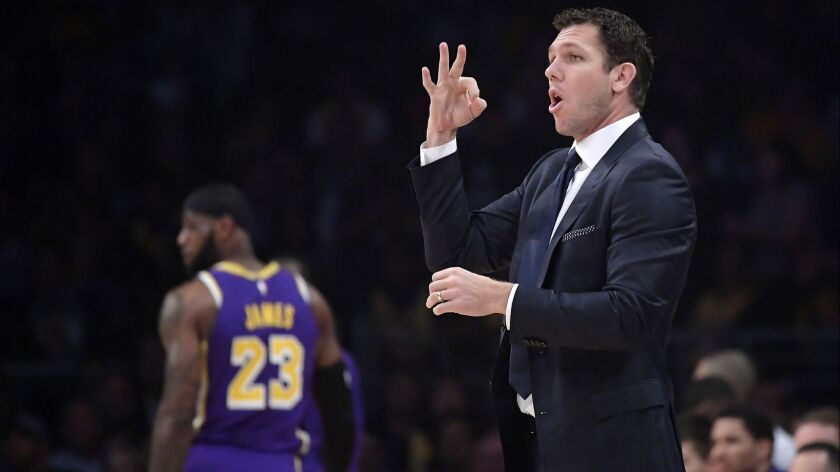 Lakers coach Luke Walton gestures as forward LeBron James stands in the background during a game against Minnesota on Nov. 7 at Staples Center.