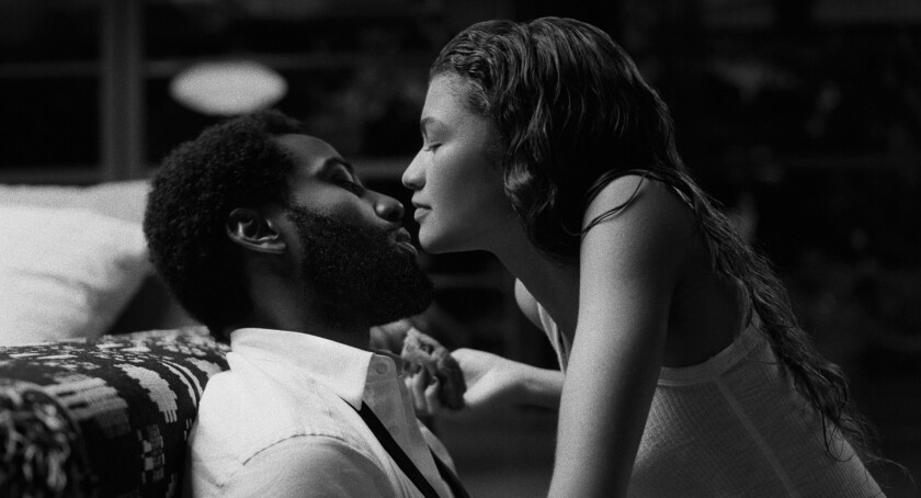 "John David Washington and Zendaya touching faces in ""Malcolm & Marie."""