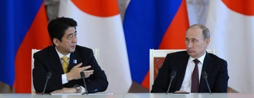 No pushovers when it comes to protecting their countries' national interests, Japanese Prime Minister Shinzo Abe, left, and Russian President Vladimir Putin agreed at a Kremlin summit on Monday to resurrect long-dormant negotiations aimed at signing a peace treaty to end World War II. A territorial dispute has stood in the way since fighting ended in 1945.