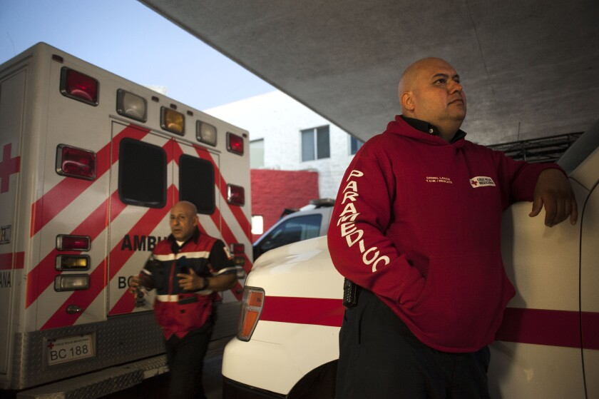 Mexican Red Cross paramedic Daniel Larios waits for a call outside the Red Cross hospital on Friday in Tijuana.
