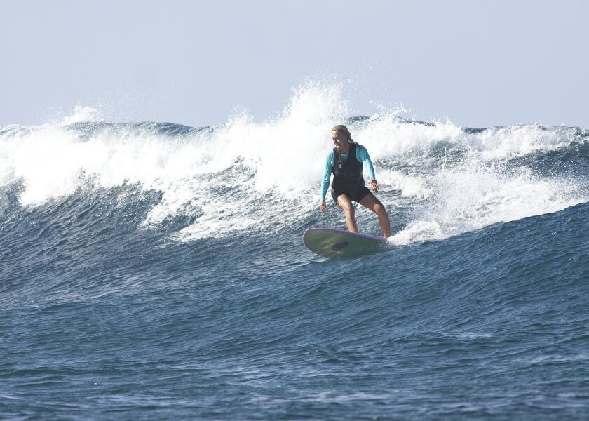 Surfing burns around 200 calories per hour. Some put that number as high as 600. Courtesy of Surf Diva