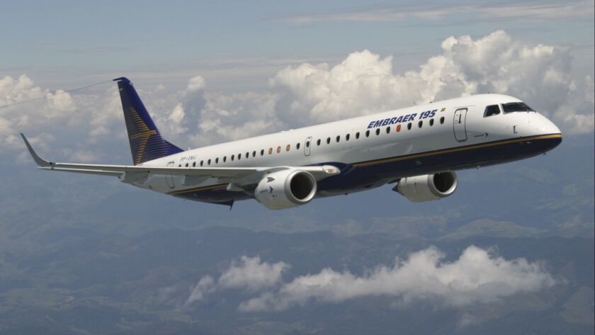 In this undated photo released by Brazilian aircraft manufacturer Embraer, an E-195 large regional j