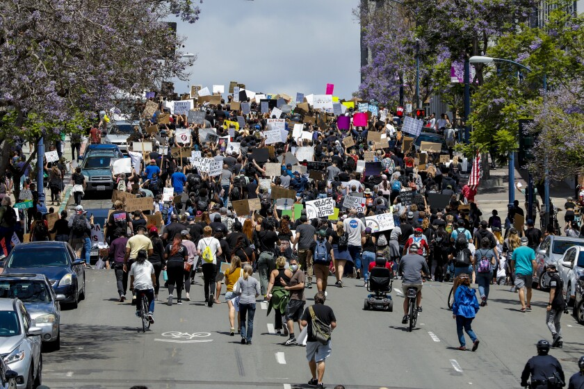Protestors march to the San Diego Police Department