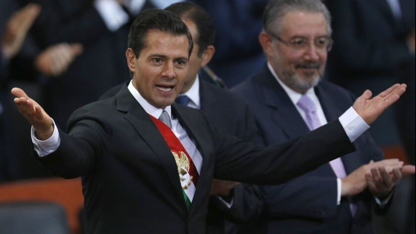 Mexico's President Enrique Pena Nieto acknowledges invited guests before delivering his annual state