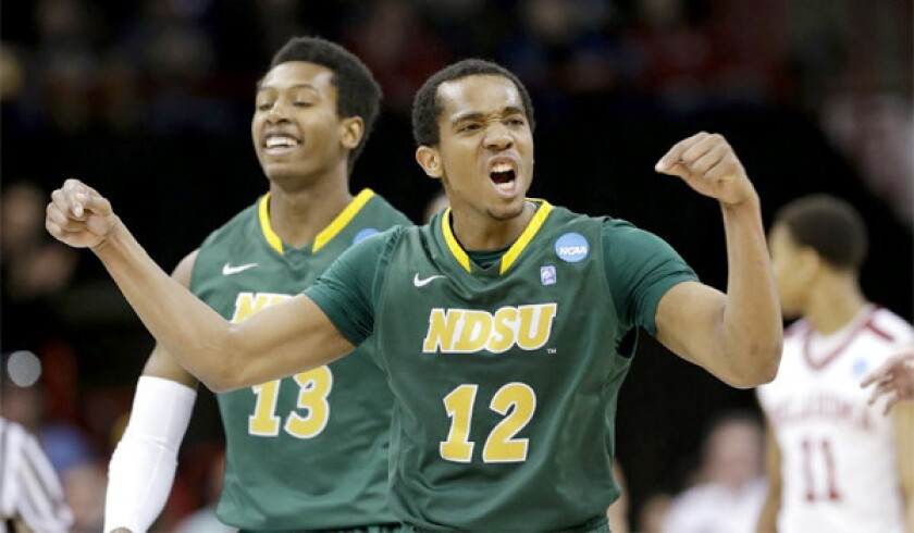 Lawrence Alexander of 12th-seeded North Dakota State celebrates during the Bison's upset of fifth-seeded Oklahoma, 80-75, in overtime of the second round of the NCAA tournament.