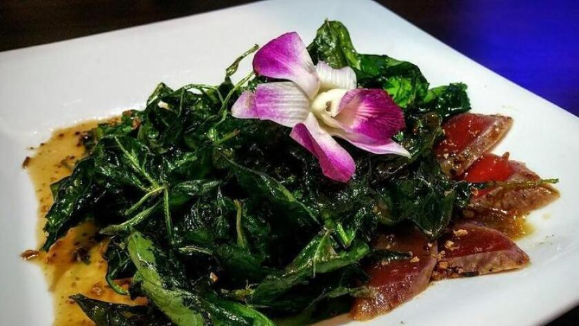 """The """"Popeye"""" Fried spinach salad with ahi comes dressed in a sweet and tangy soy-whole grain mustard vinaigrette at Fusion Izakaya. (Amy T. Granite)"""