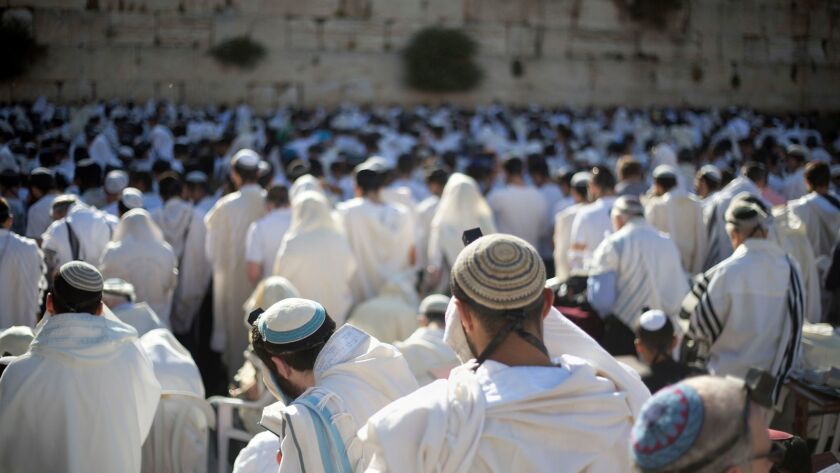 Jewish men pray at the Western Wall during Jerusalem Day celebrations on May 24.