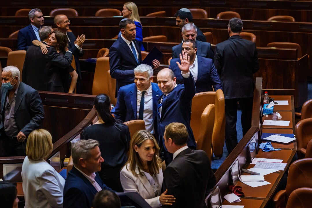 Naftali Bennett waves to crowd at Knesset.