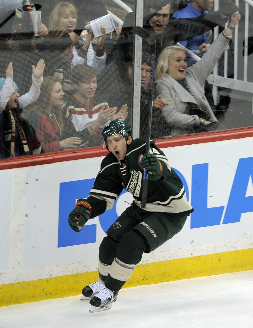 Minnesota Wild's Justin Fontaine celebrates his goal against Dallas Stars in the first period of an NHL hockey game, Tuesday, Feb. 9, 2016, in St. Paul, Minn. (AP Photo/Tom Olmscheid)