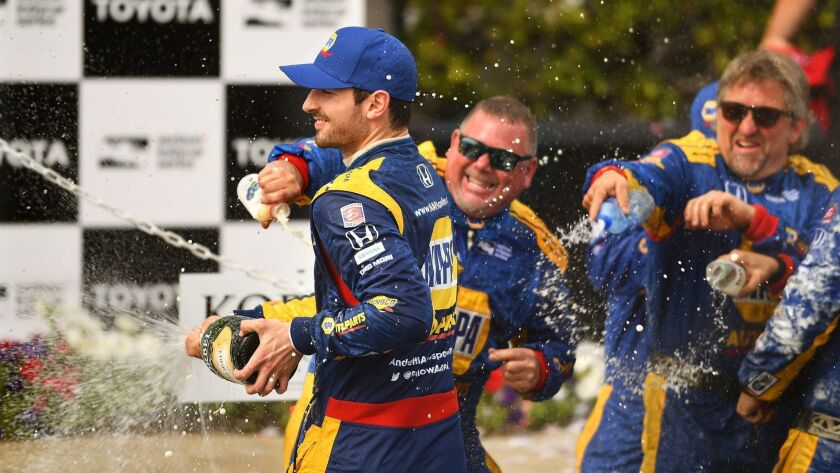 LONG BEACH-CA-APRIL 15, 2018: Alexander Rossi, left, celebrates with his team after finishing first