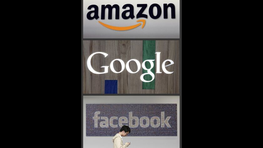 FILE - This photo combo of images shows the Amazon, Google and Facebook logos. A review into competi