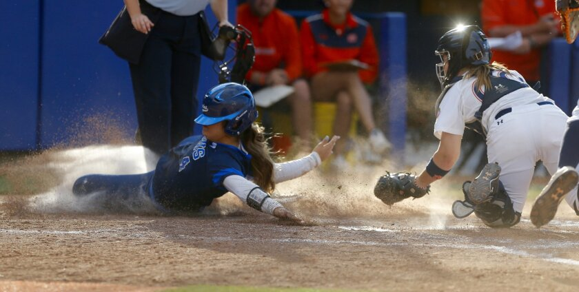 UCLA's Gabrielle Maurice, left, is tagged out by Auburn's Carlee Wallace during an NCAA Women's College World Series game in Oklahoma City, Saturday, May 30, 2015. (Sarah Phipps/The Oklahoman via AP) LOCAL STATIONS OUT (KFOR, KOCO, KWTV, KOKH, KAUT OUT); LOCAL WEBSITES OUT; LOCAL PRINT OUT (EDMOND SUN OUT, OKLAHOMA GAZETTE OUT) TABLOIDS OUT