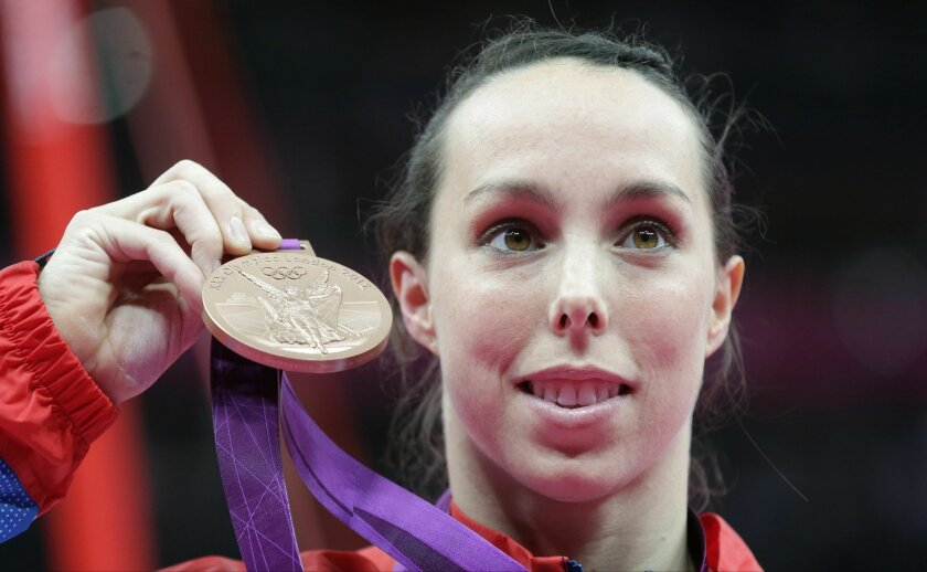 FILE - This is a Monday, Aug. 6, 2012  file photo of Britain's gymnast Elizabeth Tweddle as she displays the bronze medal for her performance on the uneven bars during the artistic gymnastics women's apparatus finals at the 2012 Summer Olympics in London. Olympic bronze medalist gymnast Beth Tweddl