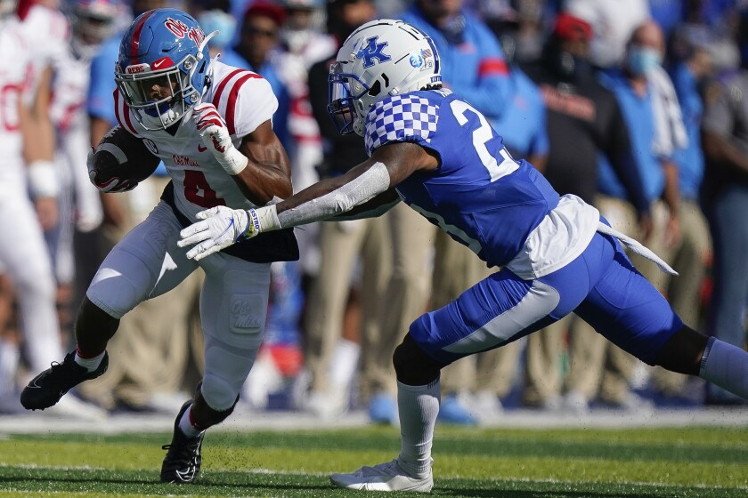 Kentucky defensive back Tyrell Ajian (23) tackles Mississippi running back Tylan Knight (4) during the first half of an NCAA college football game, Saturday, Oct. 3, 2020, in Lexington, Ky. (AP Photo/Bryan Woolston)