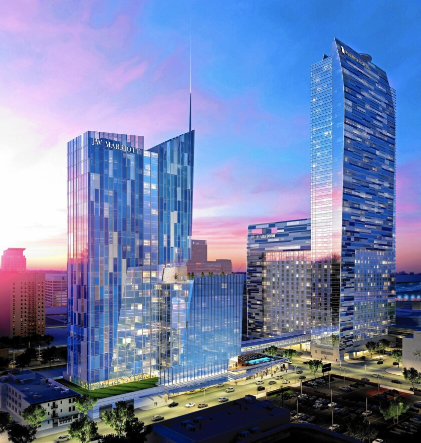 AEG will add 755 rooms to the J.W. Marriott in a new high-rise connected to the existing hotel building by a bridge over Olympic Boulevard, as seen here in an artist's rendering of the project.