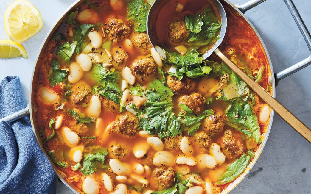 A simple soup is flavored with lamb meatballs, greens and beans in this good-on-your-gut dish.