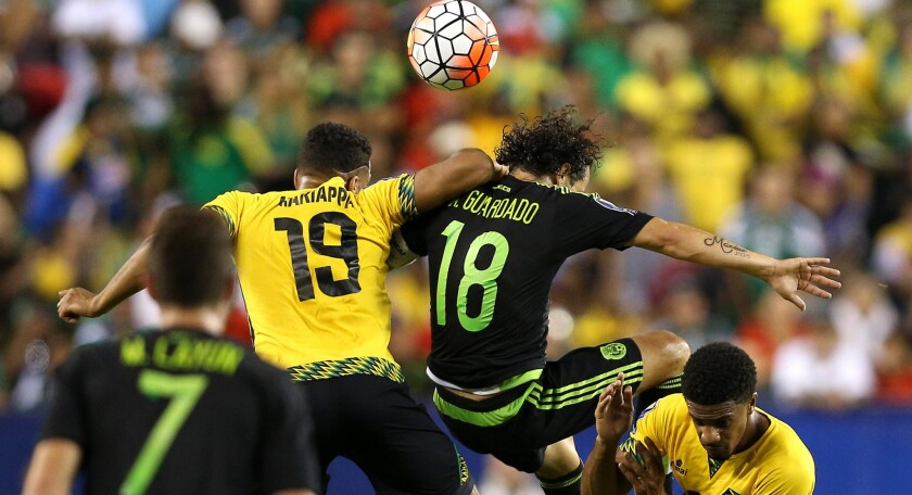 PHILADELPHIA, PA - JULY 26: Adrian Mariappa #19 of Jamaica and Andres Guardado #18 of Mexico battle for a head ball in the first half during the CONCACAF Gold Cup Final at Lincoln Financial Field on July 26, 2015 in Philadelphia, Pennsylvania. Mexico won, 3-1. (Photo by Patrick Smith/Getty Images) ** OUTS - ELSENT, FPG - OUTS * NM, PH, VA if sourced by CT, LA or MoD **