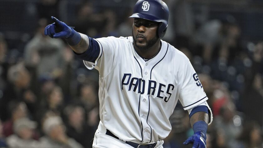 The Padres' Franmil Reyes points to the dugout after hitting a two-run home run during the sixth inning of a baseball game against the Miami Marlins at Petco Park on May 29, 2018 in San Diego, California.