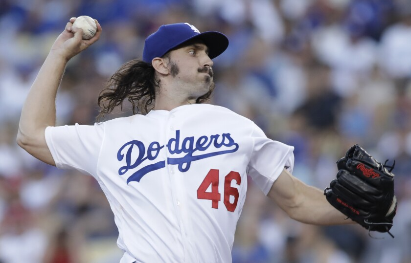 Dodgers pitcher Tony Gonsolin delivers against the St. Louis Cardinals on Monday.