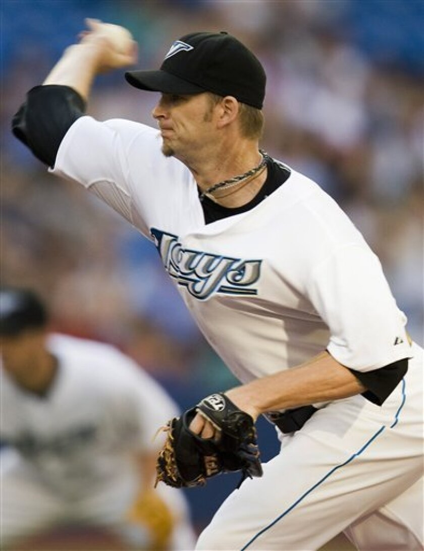 ** CORRECTS MONTH TO JULY ** Toronto Blue Jays starting pitcher A.J. Burnett pitches during the third inning of a baseball game against the Tampa Bay Rays in Toronto on Monday, July 28, 2008. (AP Photo/The Canadian Press, Frank Gunn)