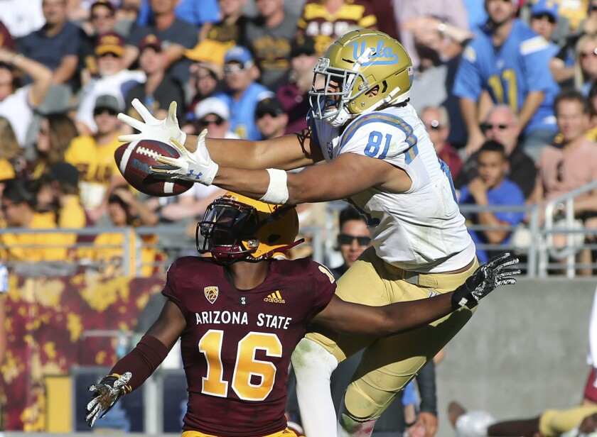 UCLA tight end Caleb Wilson (81) leaps to catch a pass over Arizona State defensive back Aashari Cro
