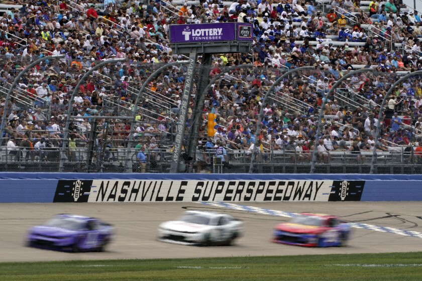Cars come down the main straightaway at Nashville Superspeedway during a NASCAR Xfinity Series auto race Saturday, June 19, 2021, in Lebanon, Tenn. (AP Photo/Mark Humphrey)