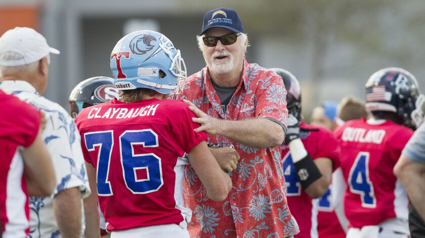Brethren Christian High coach Pat McInally, shown coaching the South team in the 58th annual Orange County All-Star Classic on June 30, retired as the Brethren Christian football program was eliminated.