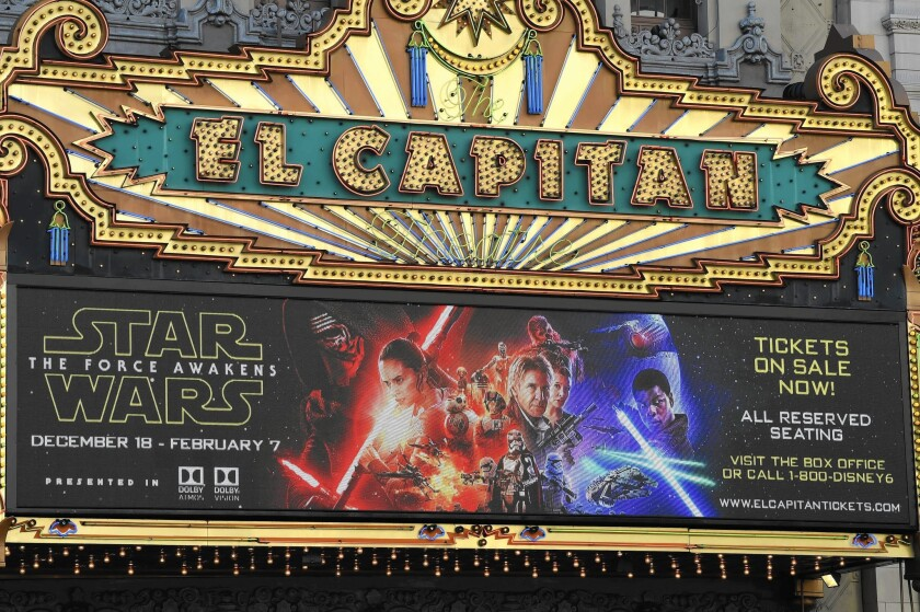 """""""Star Wars: The Force Awakens"""" is expected to gross $175 million to more than $200 million in the U.S. and Canada in its opening weekend. Above, the El Capitan theater in Hollywood promotes soon-to-be-released flim."""