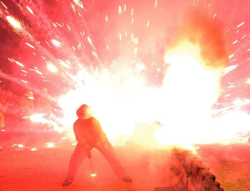 A photograph of a mortar that exploded on the ground during La Jolla's Fourth of July fireworks show. An environmental attorney who snuck into the secured area was escorted out less than a minute before the mishap, which representatives for Fireworks America say could have caused her serious bodily