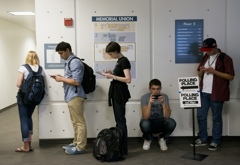 Students at UC Davis line up to vote at a polling place set up at the Memorial Union on campus in November.