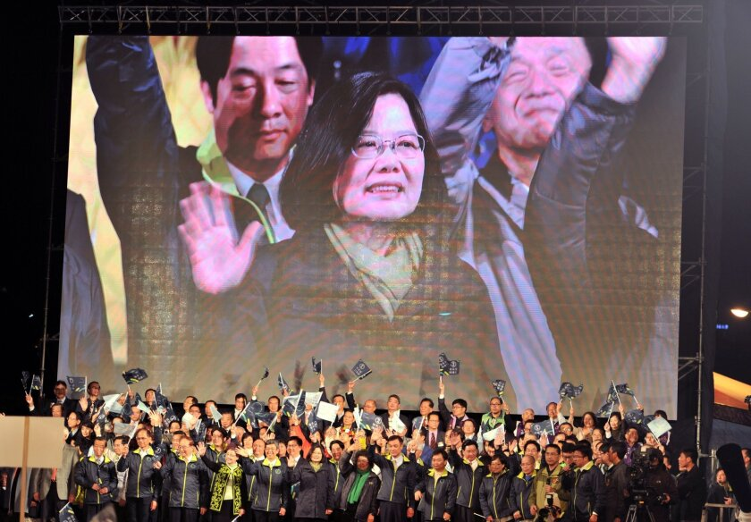 Taiwan President-elect Tsai Ing-wen appears on a screen as she celebrates her victory alongside party officials in Taipei, Taiwan.