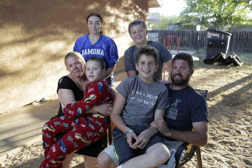 The Smith family, clockwise from top left: Ryann, 16; Troy, 11; father Darrell; Darek, 14; Blake, 9; and mother Alicia.