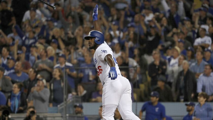 LOS ANGELES, CALIF. - SEP. 19, 2018. Dodgers pinch hitter Yasiel Puig strokes a three-run homer ag