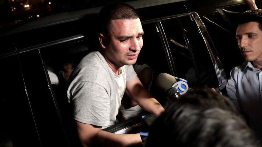 Pablo Villavicencio leans out of an SUV while talking to reporters after being released from the Hud
