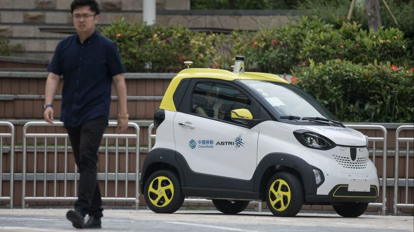 China Mobile 5G lab and driverless car test, Hong Kong - 17 Apr 2019