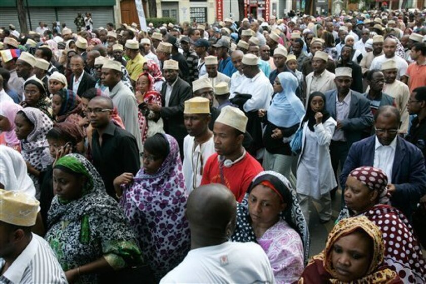 About five hundred men and women from the Comoros Islands living in France, march in memory of the victims of Tuesday's Yemenia Airways plane crash near the Comoros Islands, in Paris, Sunday July 5, 2009. (AP Photo/Michel Euler)