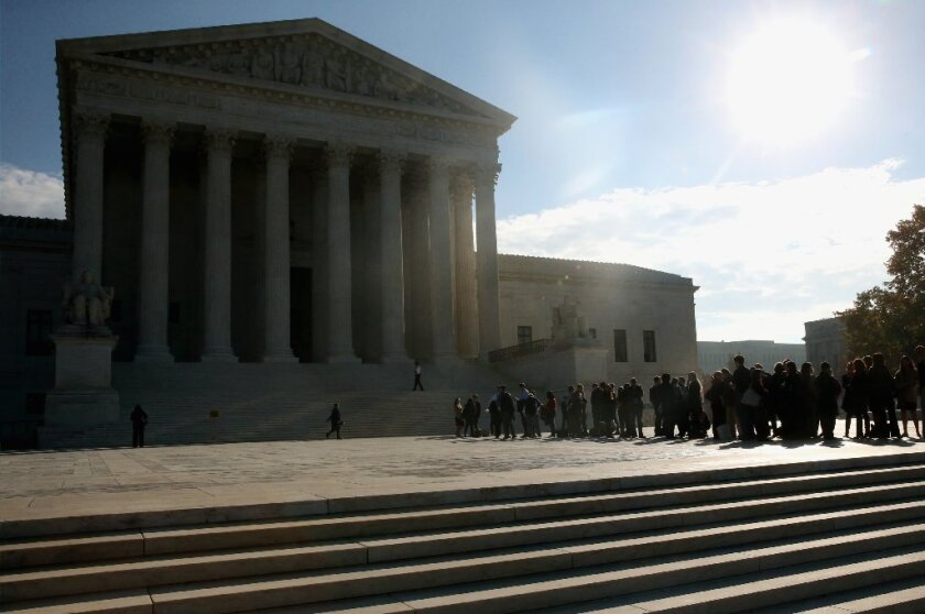 People stand in line outside the U.S. Supreme Court building in November.