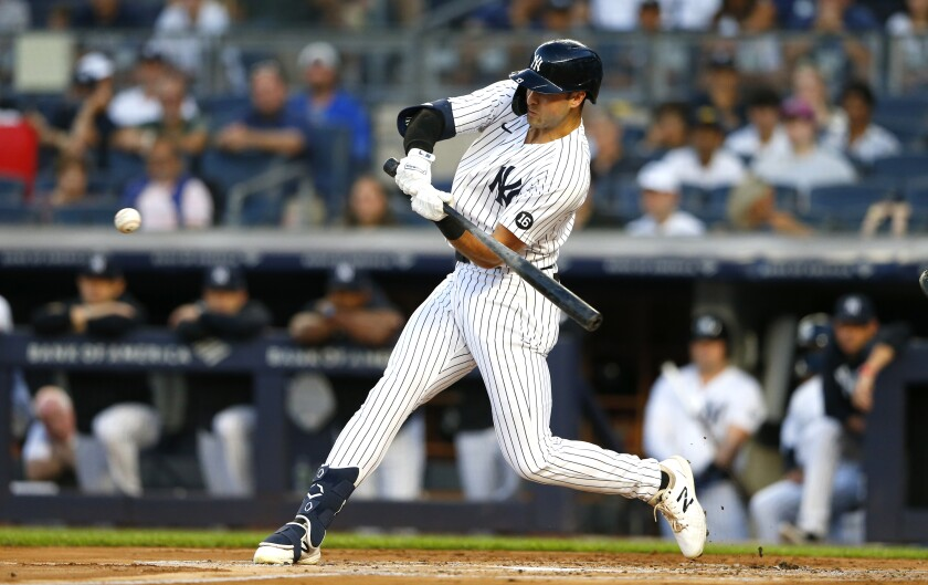 New York Yankees' Joey Gallo hits a home run against the Los Angeles Angels during the first inning of a baseball game Monday, Aug. 16, 2021, in New York. (AP Photo/Noah K. Murray)