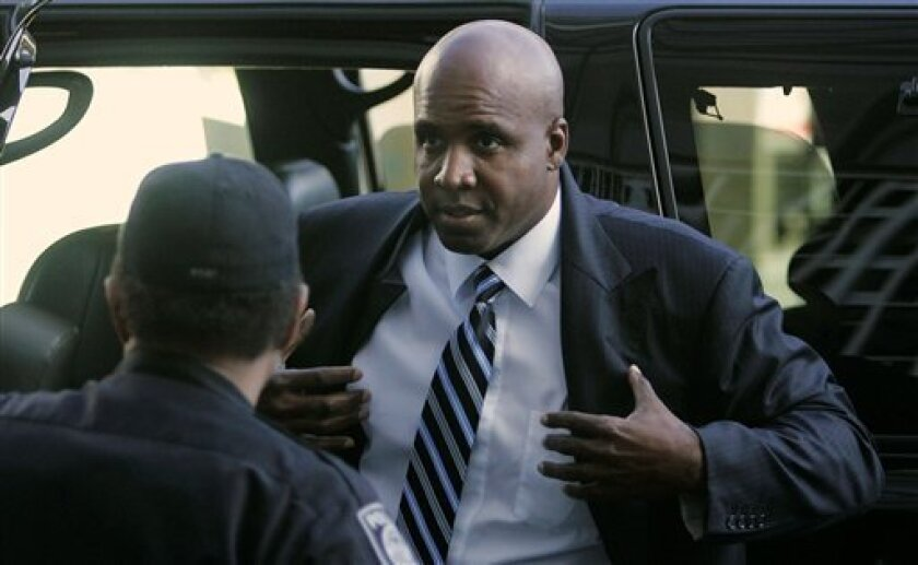 In this June 6, 2008 file photo, Former San Francisco Giants baseball player Barry Bonds arrives at the federal courthouse in San Francisco, Calif. The government's case against Barry Bonds includes several positive drug test results that prosecutors say belong to the former San Francisco Giants' slugger. That evidence will be part of hundreds of pages of court filings by prosecutors and Bonds' attorneys that a federal judge plans to unseal Wednesday, Feb. 4, 2009. (AP Photo/Marcio Jose Sanchez, File)