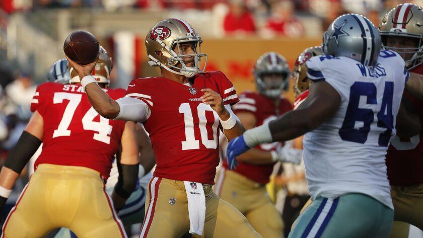 San Francisco 49ers quarterback Jimmy Garoppolo (10) against the Dallas Cowboys during an NFL preseason football game in Santa Clara, Calif., Thursday, Aug. 9, 2018.