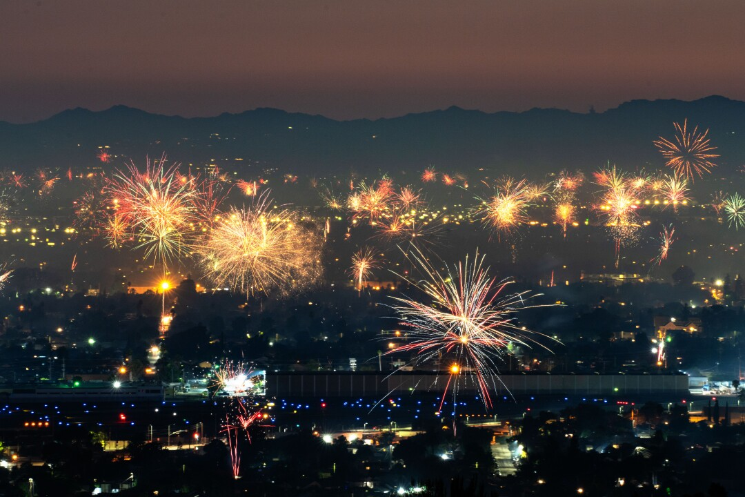 Fireworks light up the sky over North Hollywood, as seen from Burbank.